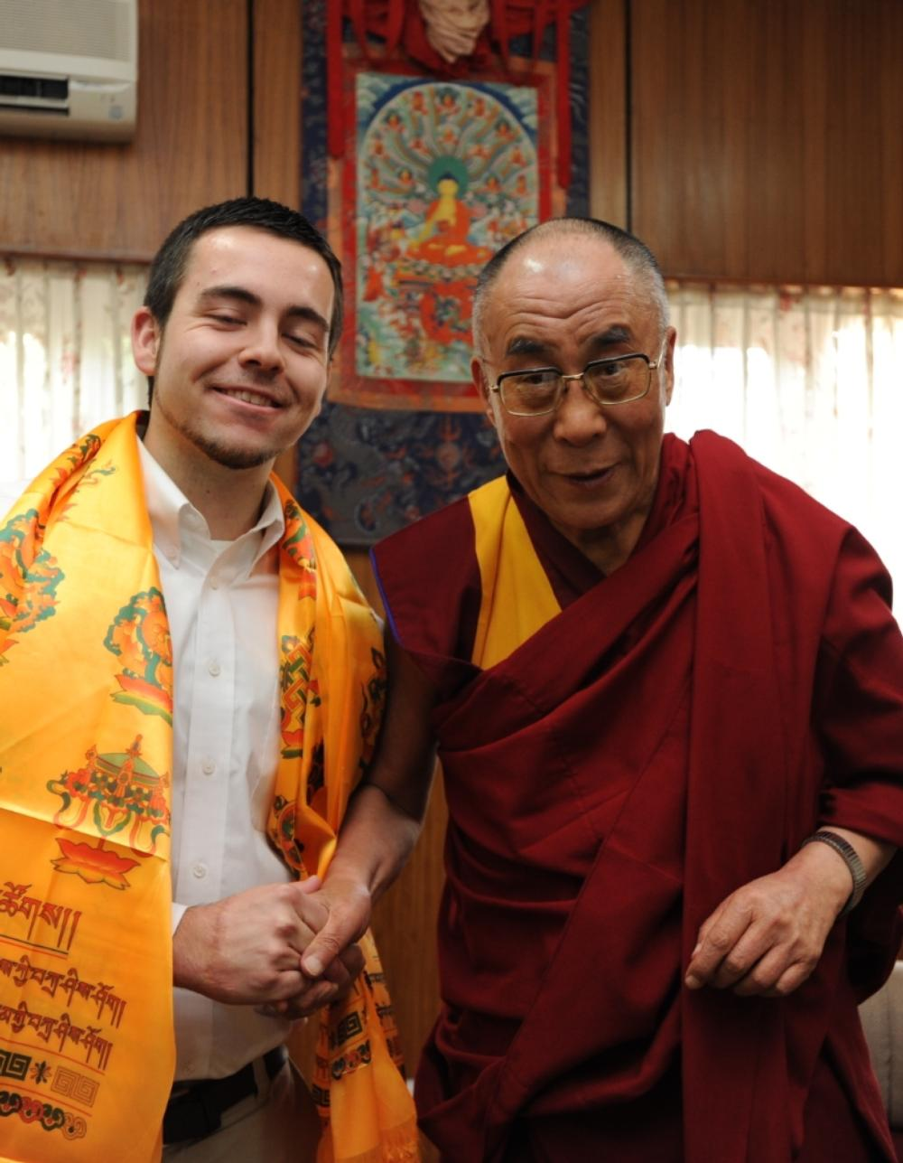Guy shaking HHDL's hand